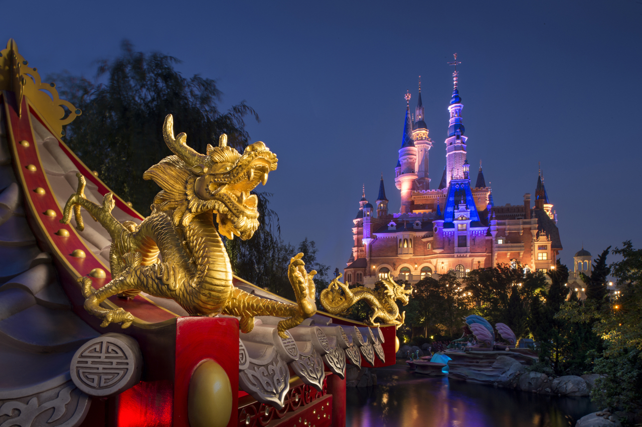 "With a unique blend of Disney magic and the beauty of China's cultural spirit, the design of Shanghai Disney Resort is ""authentically Disney and distinctly Chinese.""  That guiding principle is  incorporated throughout the resort – and it's visible here with a scene from Voyage to the Crystal Grotto, an excursion that travels the waters of Fantasyland and through the Enchanted Storybook Castle. The golden dragon is found in the attraction's ""Mulan"" scene.  The special nature of Shanghai Disney Resort celebrates Disney stories, and also salutes Chinese culture and design, with Wandering Moon Teahouse in Shanghai Disneyland, the Shikumen architectural features in Disneytown and original Chinese fonts for themed signage. (Kent Phillips, photographer)"